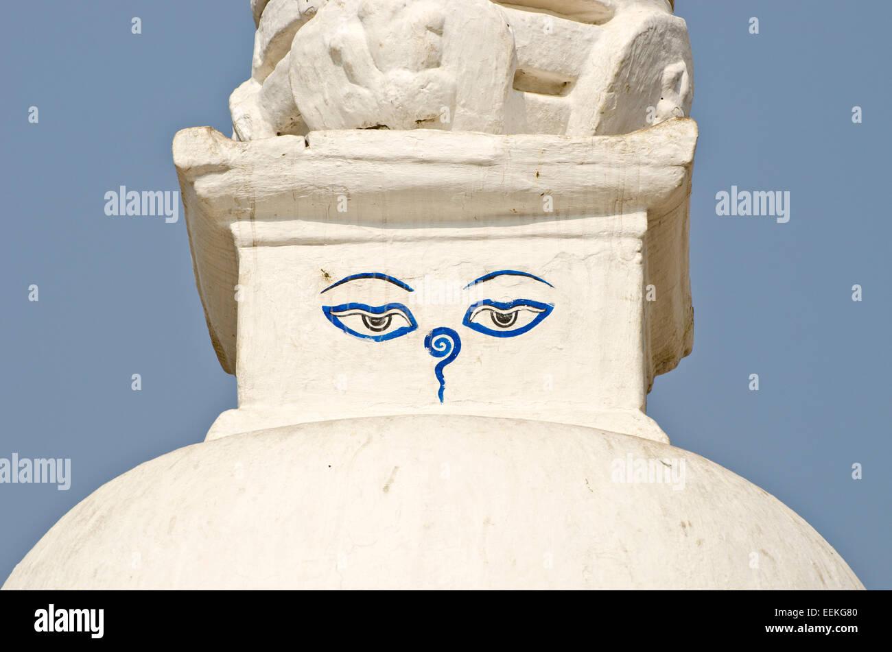 Buddha wisdom eyes on small white stupa in Kathmandu, Nepal - Stock Image
