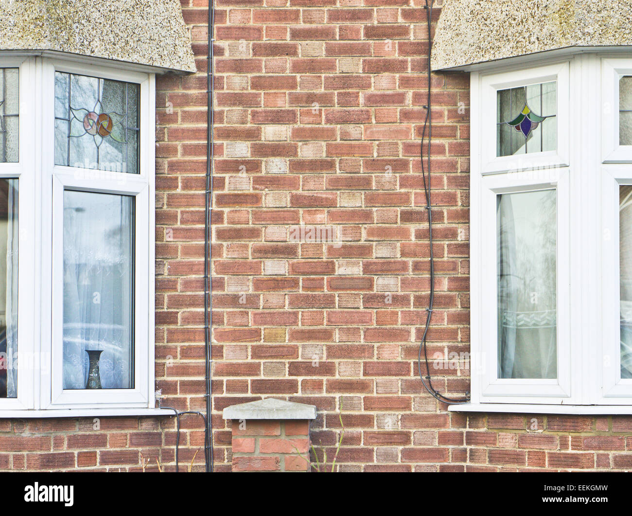 Double glazed bay windows in adjoining houses - Stock Image