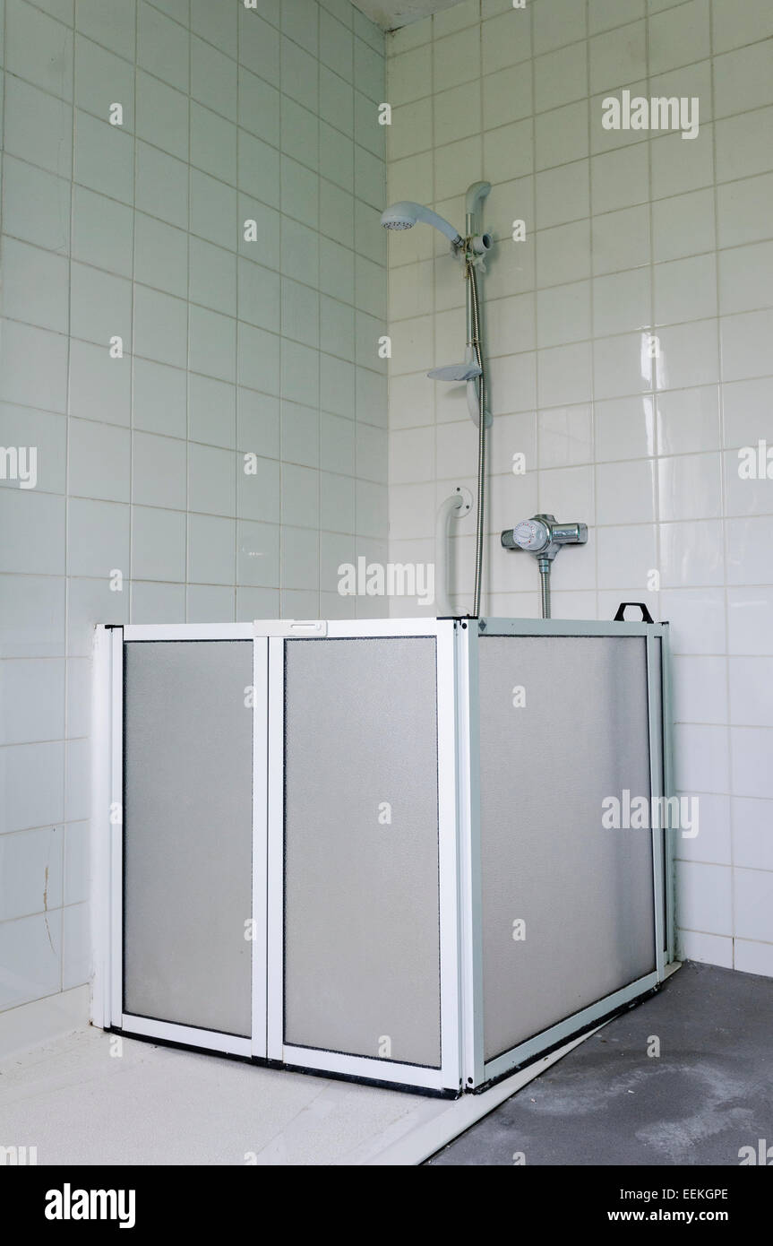 shower enclosure for a wheelchair user in a large hospital bathroom