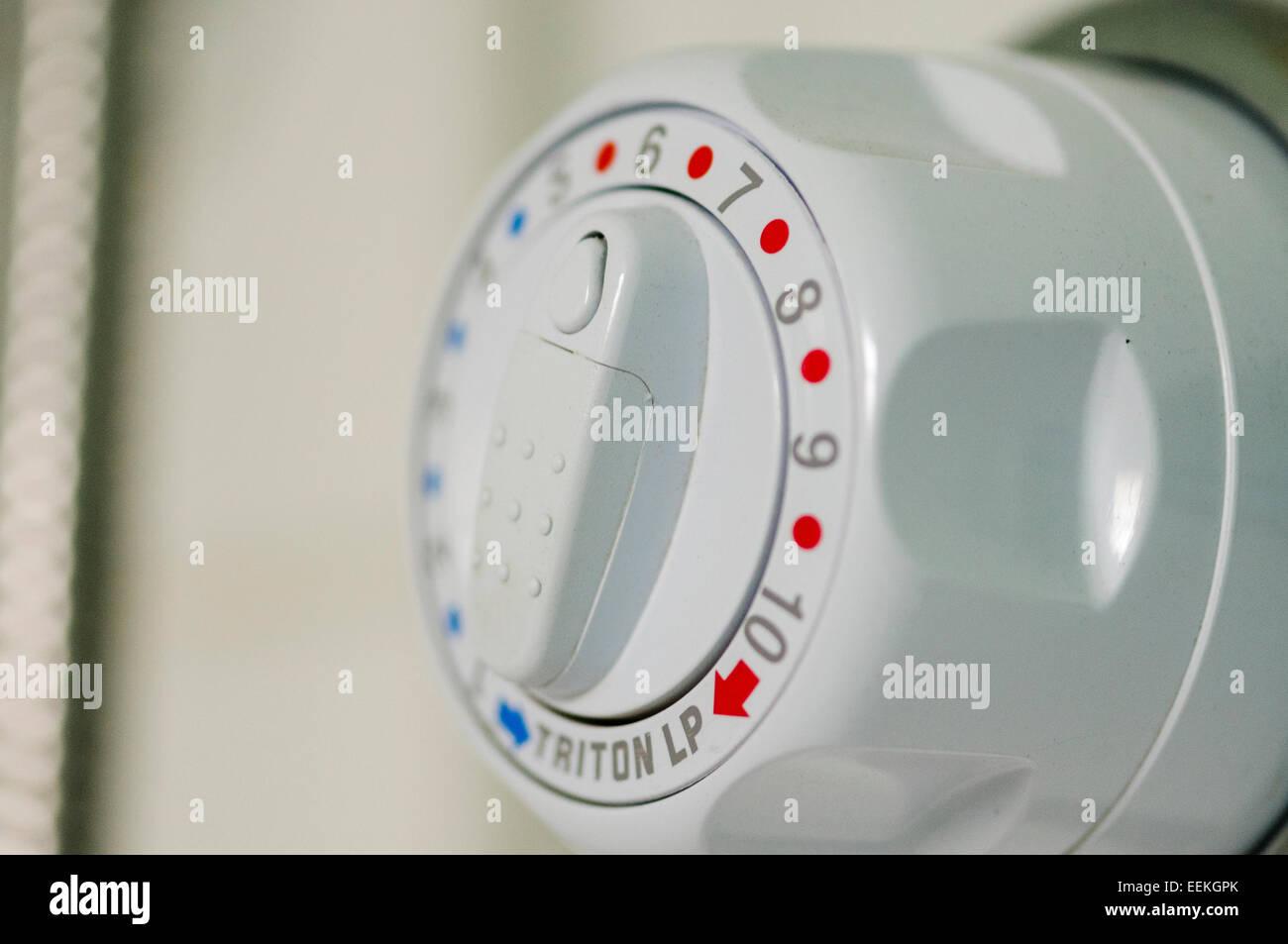 Temperature control of a shower mixer valve - Stock Image