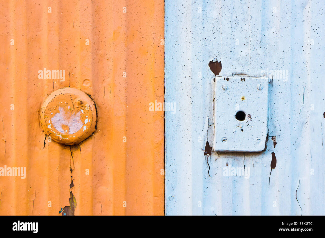 Orange and white metal surfaces as a textured abstract - Stock Image