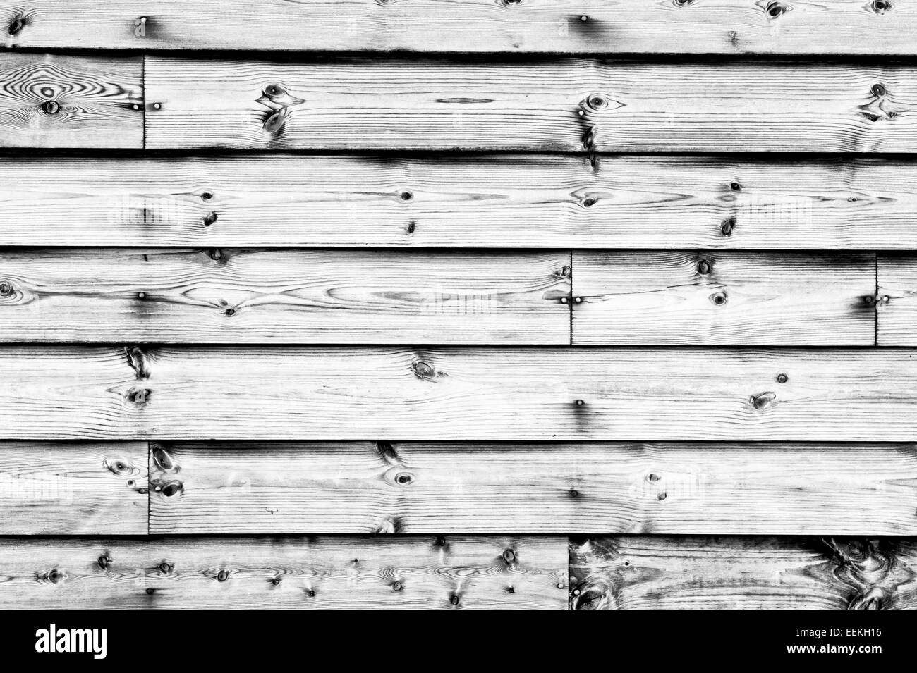 Wooden planks on a shed wall as a background - Stock Image
