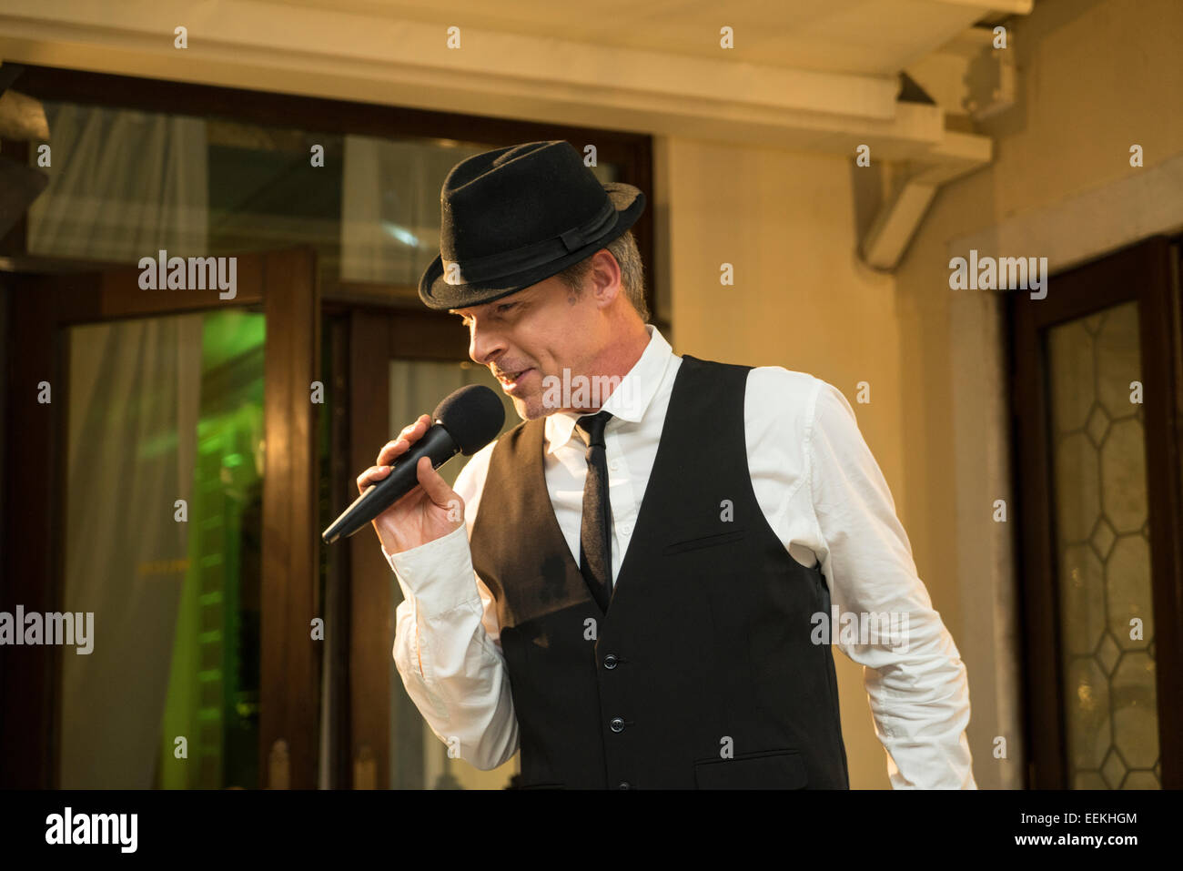Vocalist at New Year's Eve Party (Capodanno), Europa and Regina Hotel - Stock Image