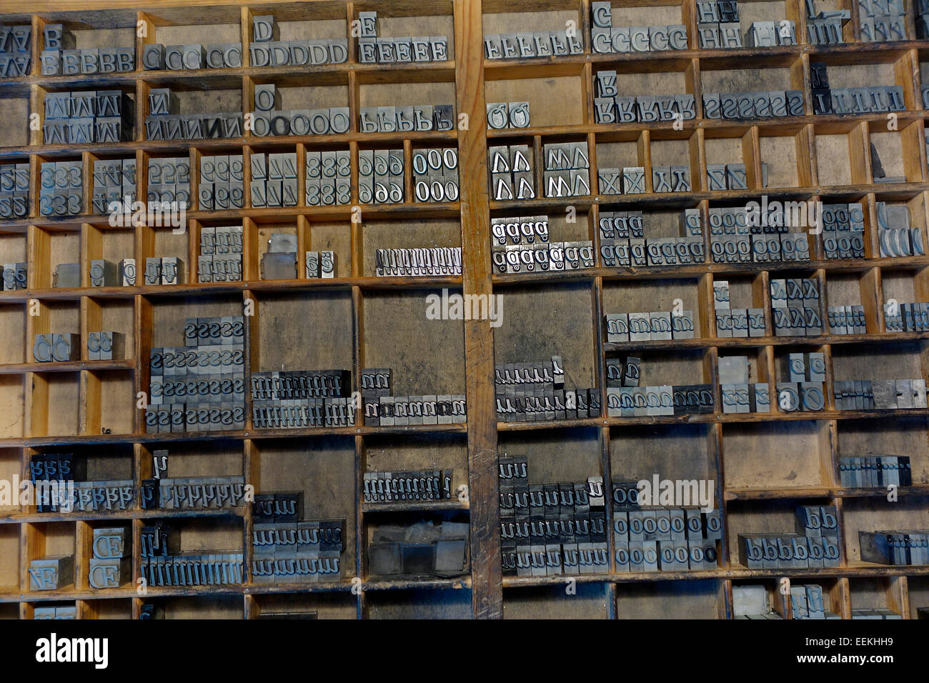 Selection of vintage cast metal sorts in original wooden drawer are ready for use in letterpress printing. - Stock Image