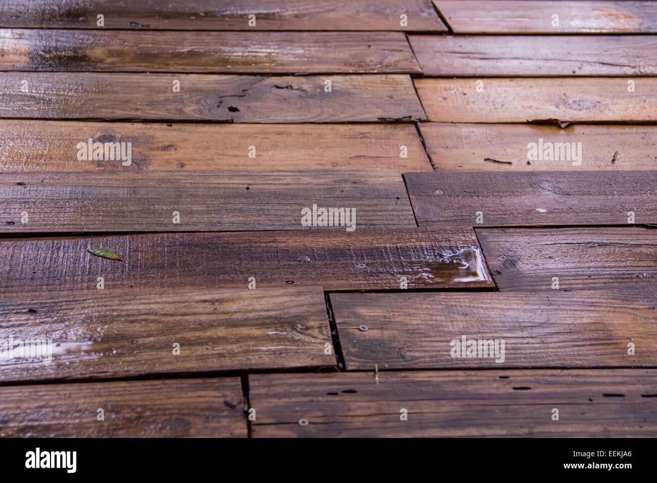 wet, warped wood. - Stock Image