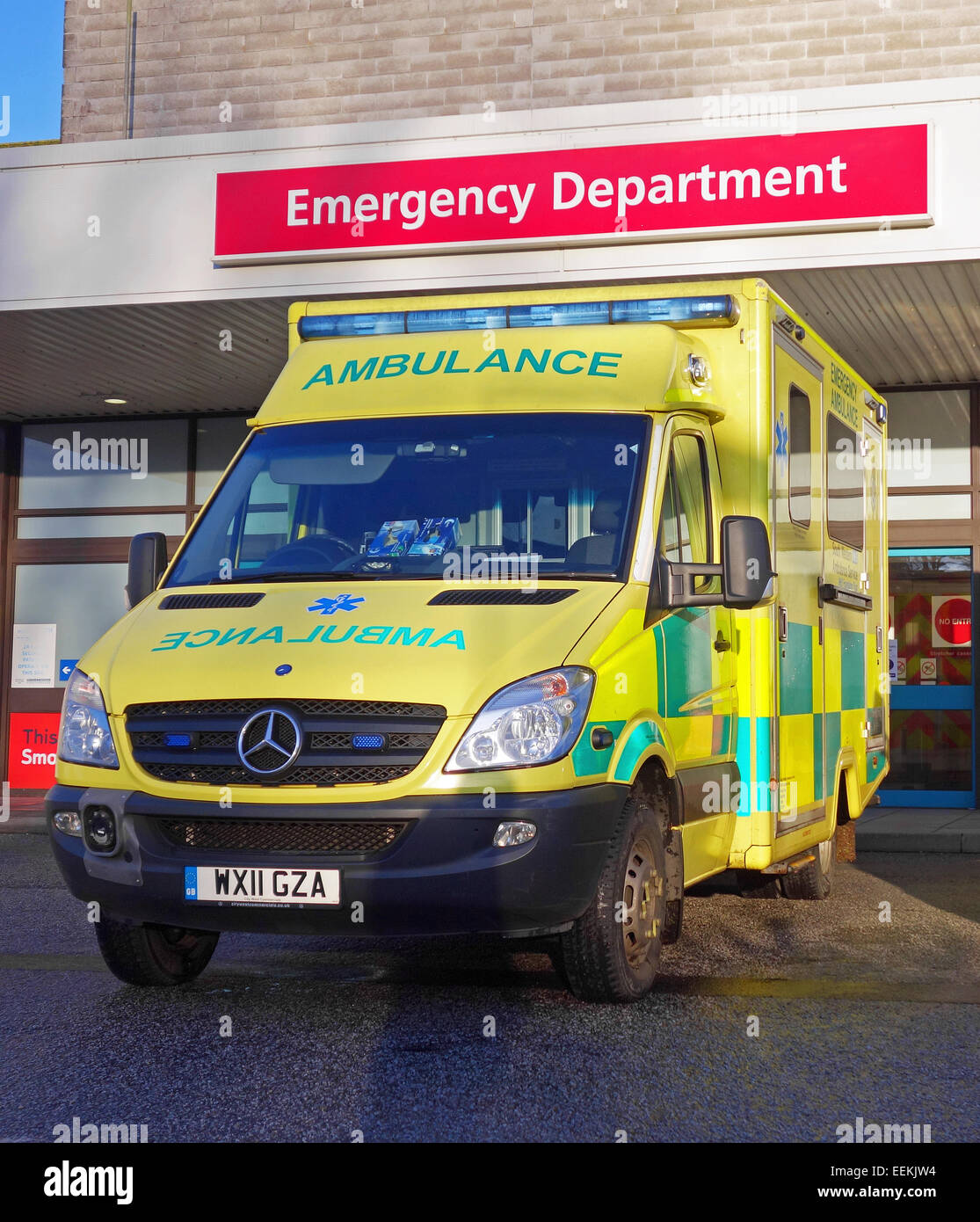 Ambulance parked outside the emergency department of a uk hospital - Stock Image