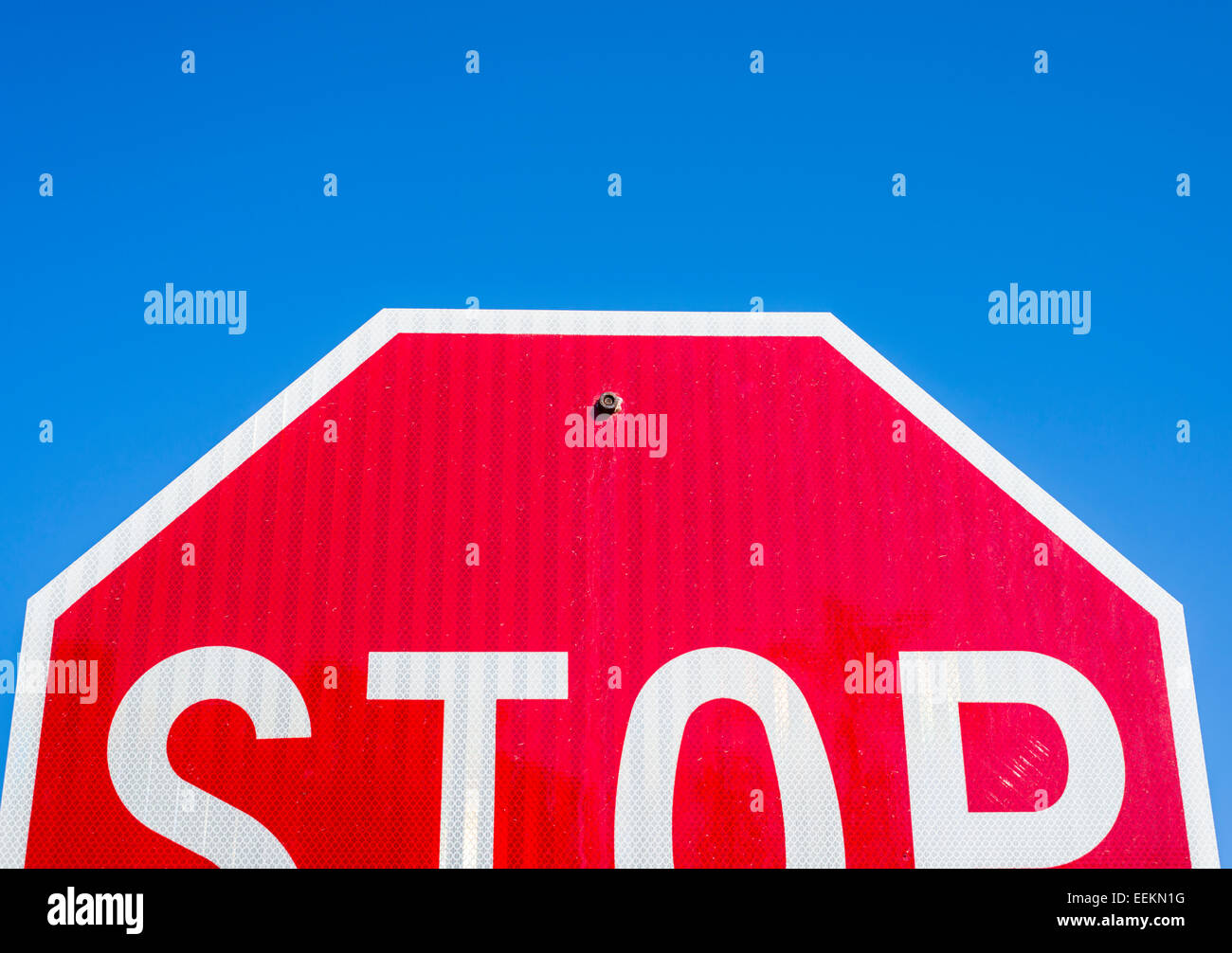 Conceptual image showing a half of a stop sign. Don't stop halfway. - Stock Image