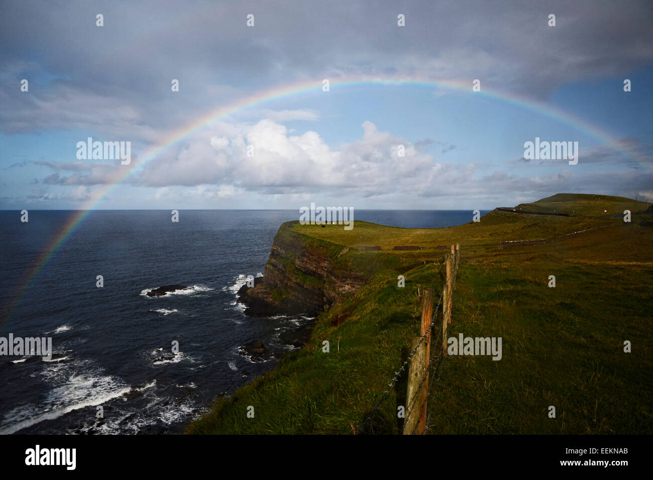 large rainbow in the rain on the north coast of Ireland - Stock Image