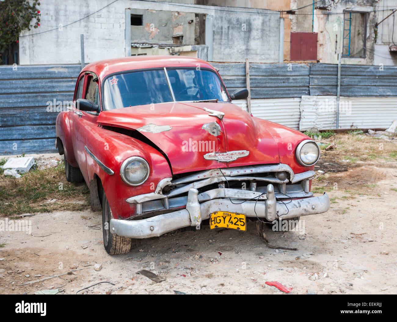Vintage, collision damaged post-accident classic red Chevrolet parked off-road in downtown Havana, capital city - Stock Image