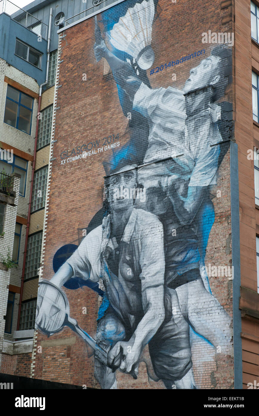Badminton Players painted on a gable wall for the XX Commonwealth Games in Glasgow, 2014. - Stock Image