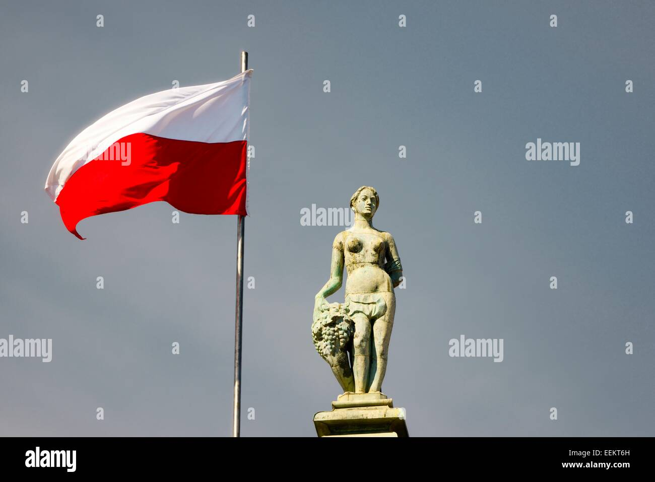 Gdansk Poland. Polish flag and statue on top of The Court of Artus in the Old Town main street of Dlugi Targ - Stock Image