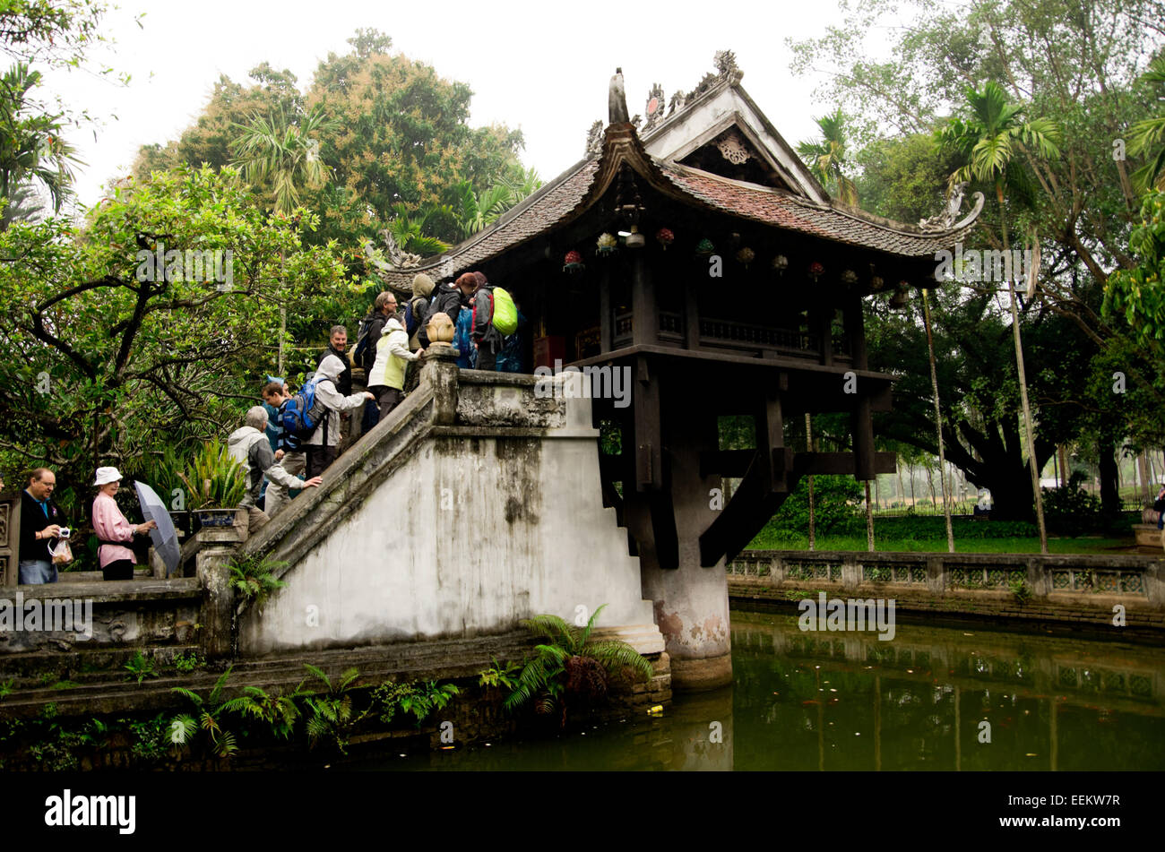 One Pillar Pagoda, visitors line up in the rain to take a look inside. - Stock Image