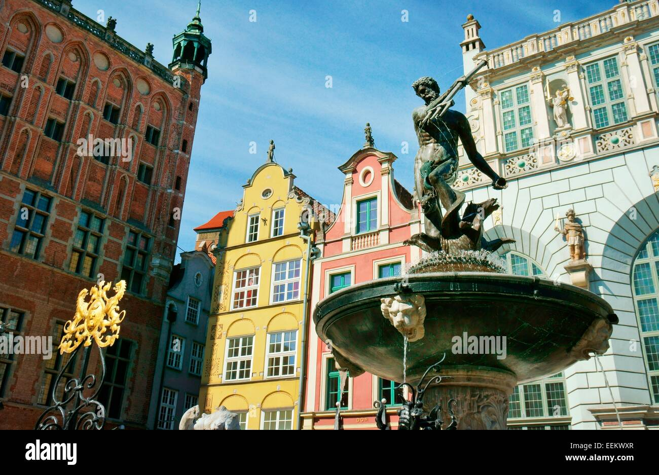 Gdansk Poland. The Neptune Fountain, erected 1633, in front of the ornate façades of the Main Town Hall and - Stock Image