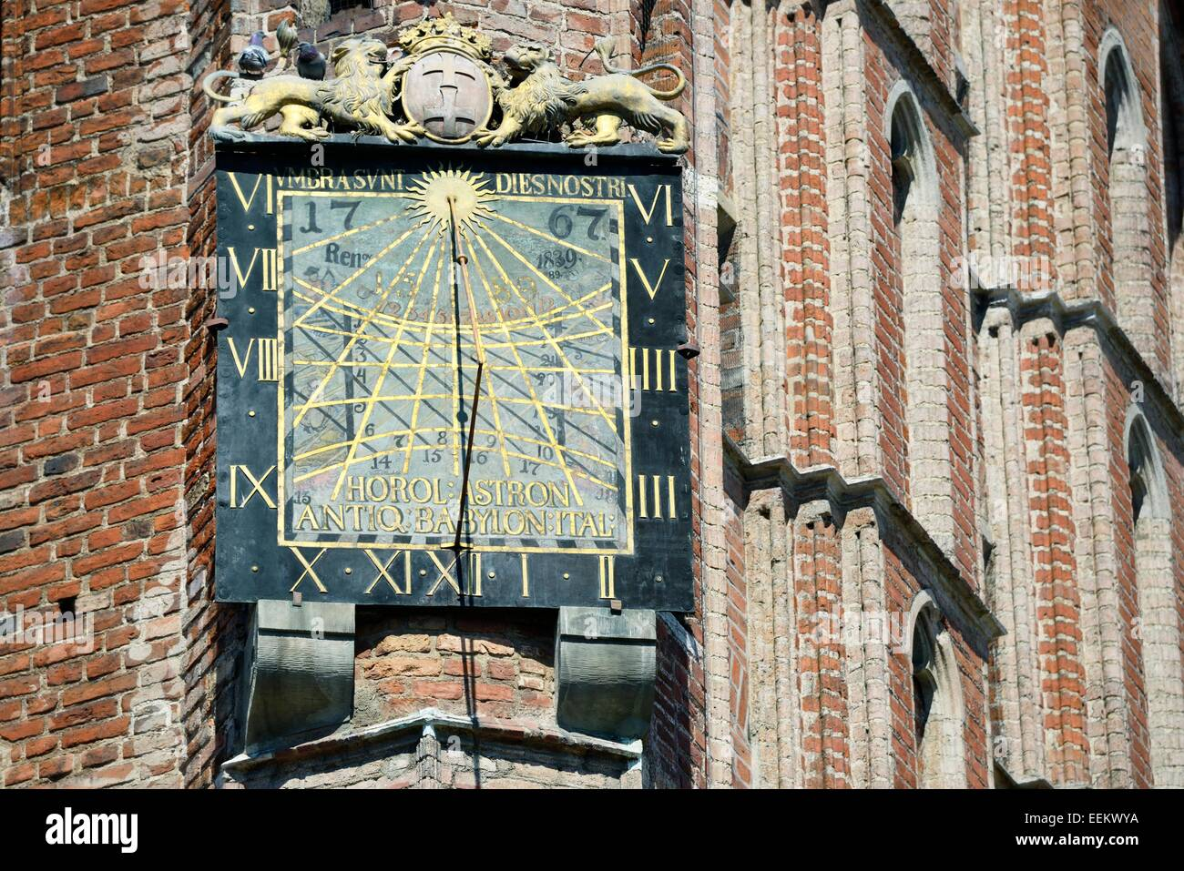 Gdansk Poland. Sun dial by Anton Glazier dating from 1589 on south wall of The Main Town Hall in the heart of the - Stock Image