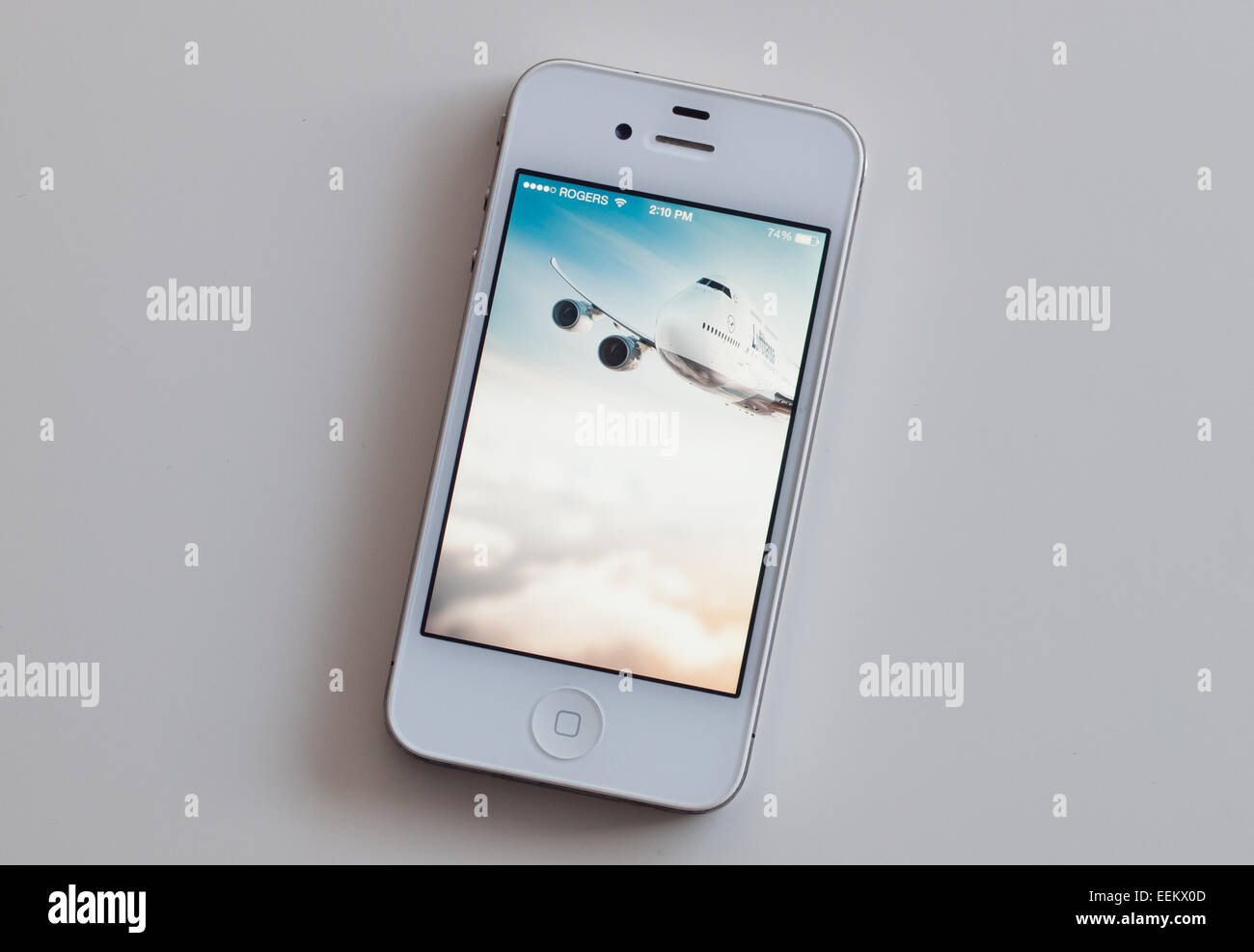 A view of the homescreen of the Lufthansa mobile app on a white Apple iPhone 4. - Stock Image