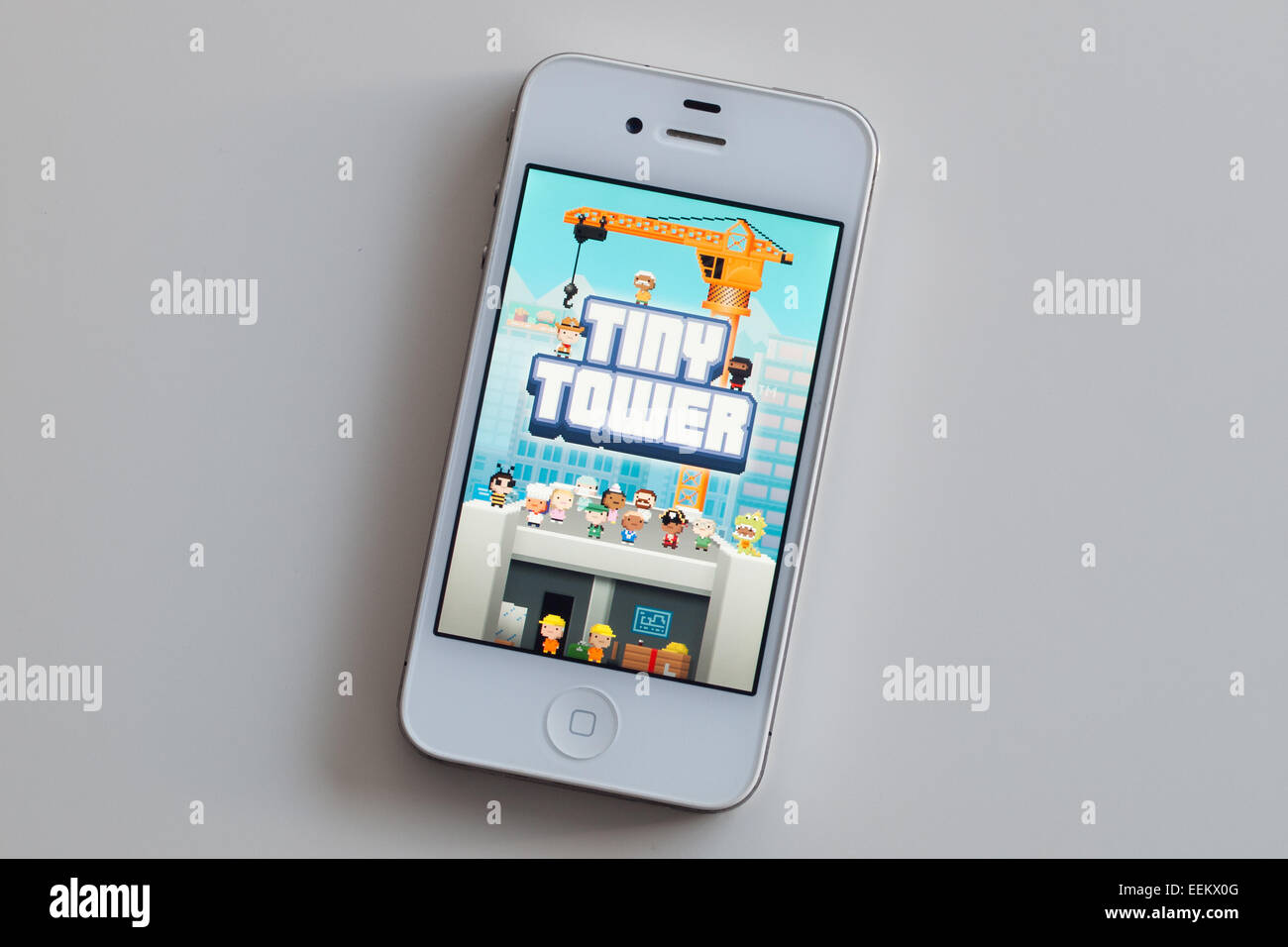 The homescreen of the Tiny Tower game, which was developed by NimbleBit,  for iOS on an Apple iPhone 4. - Stock Image