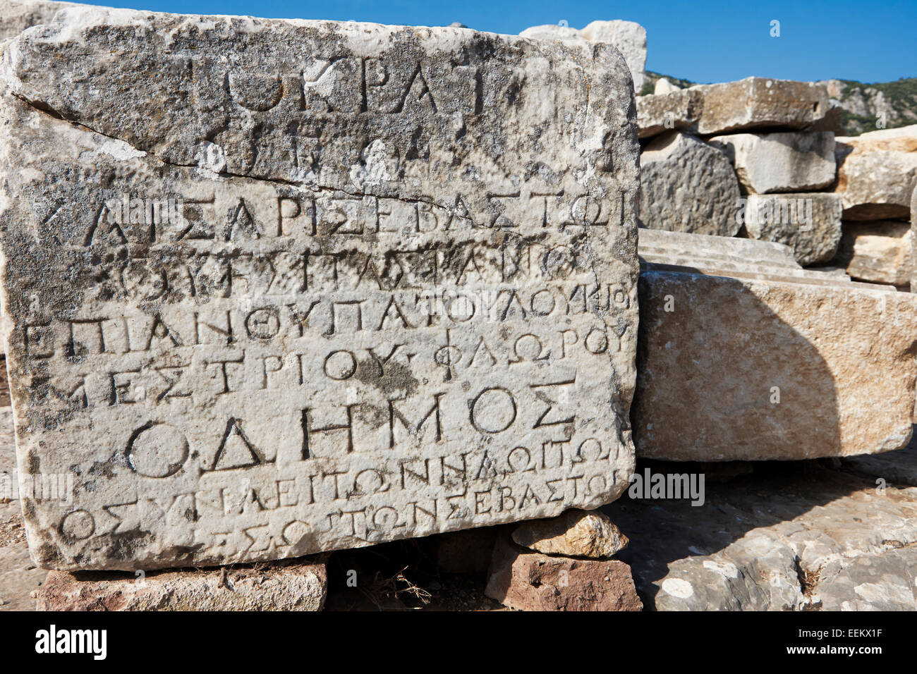 Ancient stone with inscriptions in Greek language. Ephesus Archaeological Site, Izmir province, Turkey. - Stock Image
