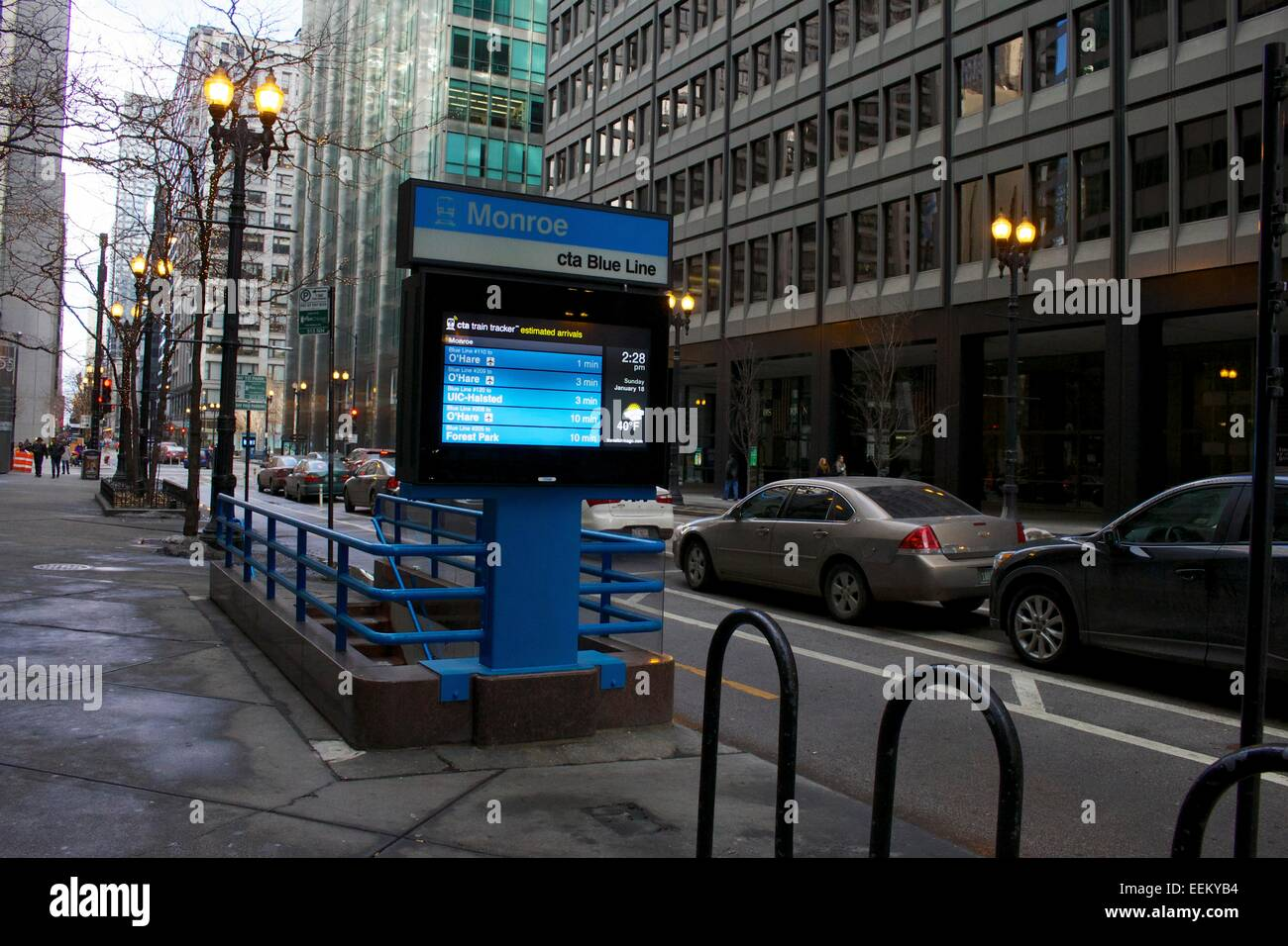CTA Blue Line Subway entrance with electronic schedule board. - Stock Image