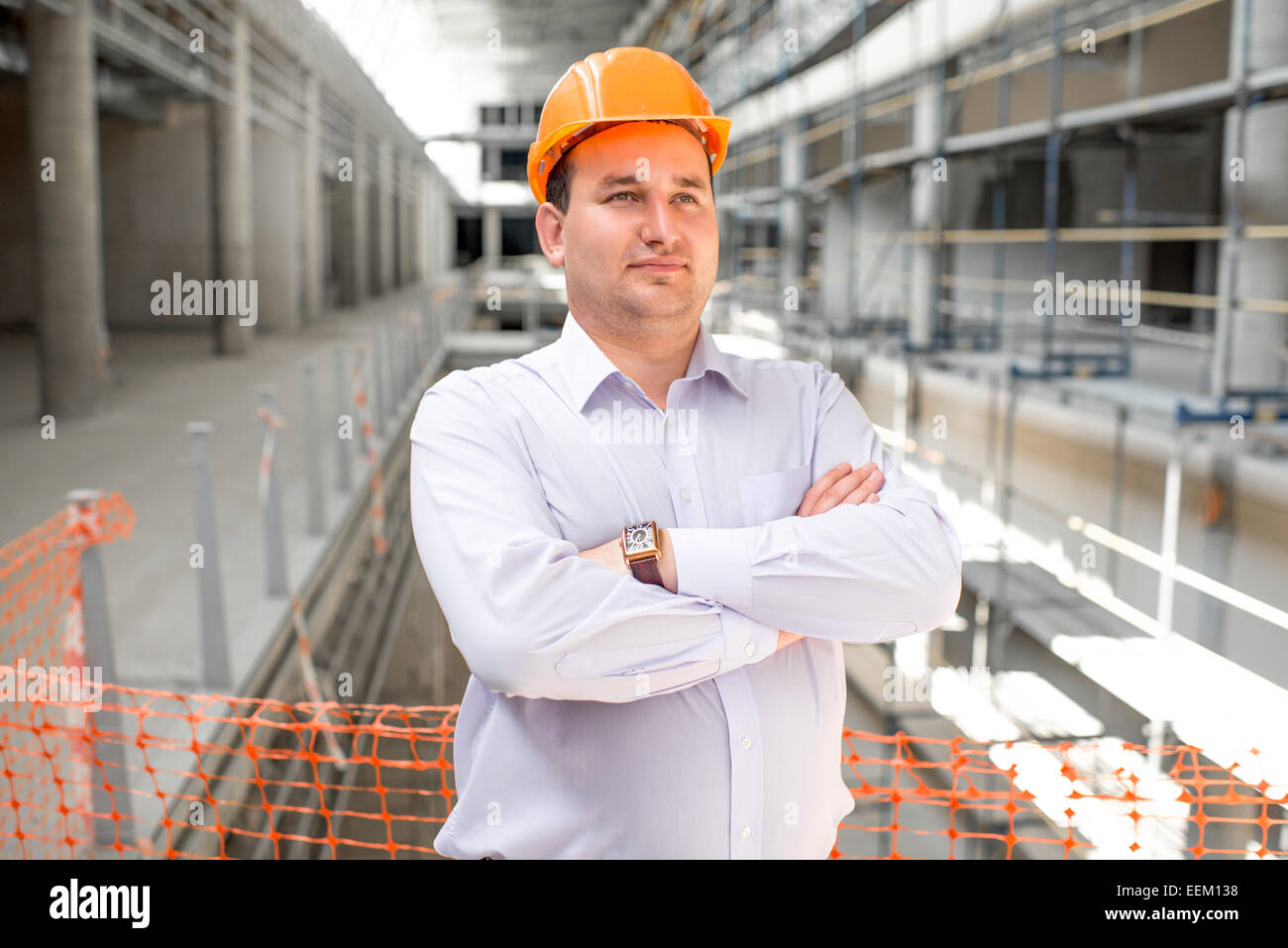 A foreman supervising the project at the construction. - Stock Image