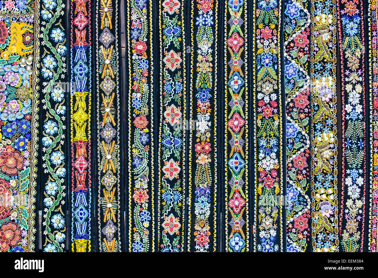 A dozen of traditional decorative belts. - Stock Image