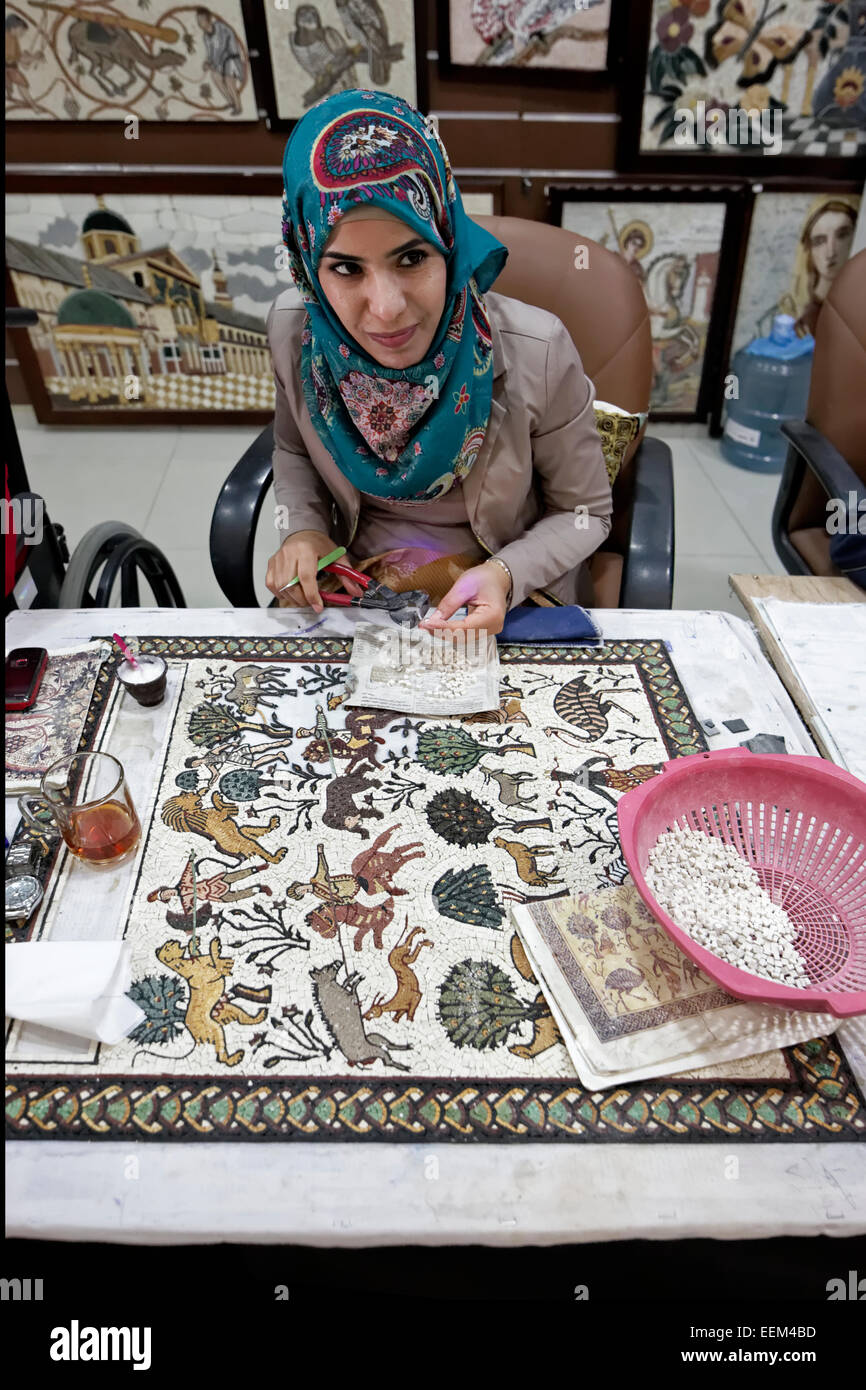 Woman working on replica of the famous mosaic of the Byzantine Franciscan Monastery Church, Mount Nebo, near Madaba, - Stock Image