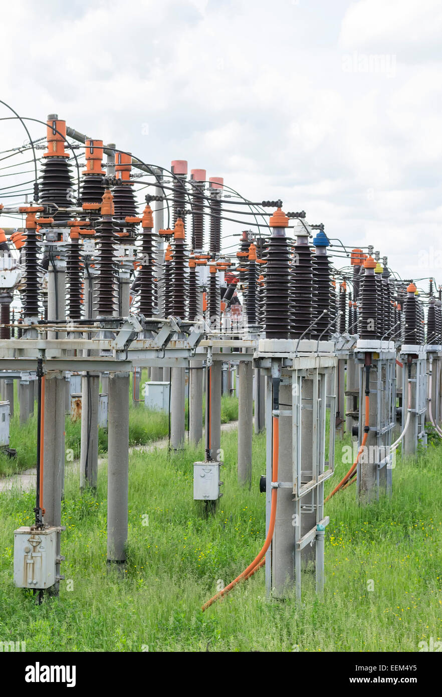 Small and medium power electric coils array at an electric transformation station - Stock Image