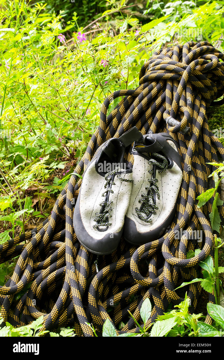 Rock climber's essential gear, dynamic rope and climbing shoes - Stock Image