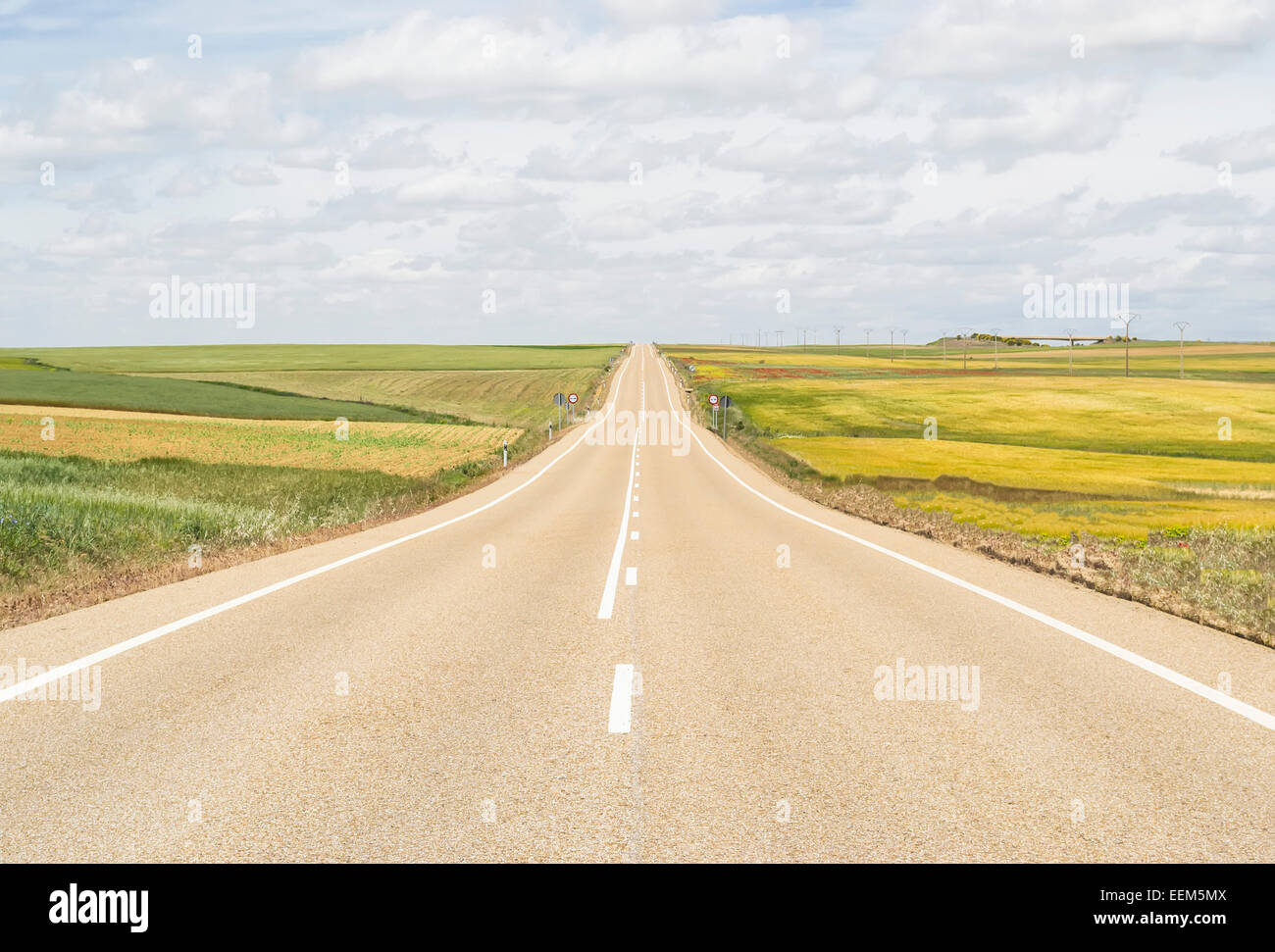 Open road through a plain that never seems to end Stock Photo