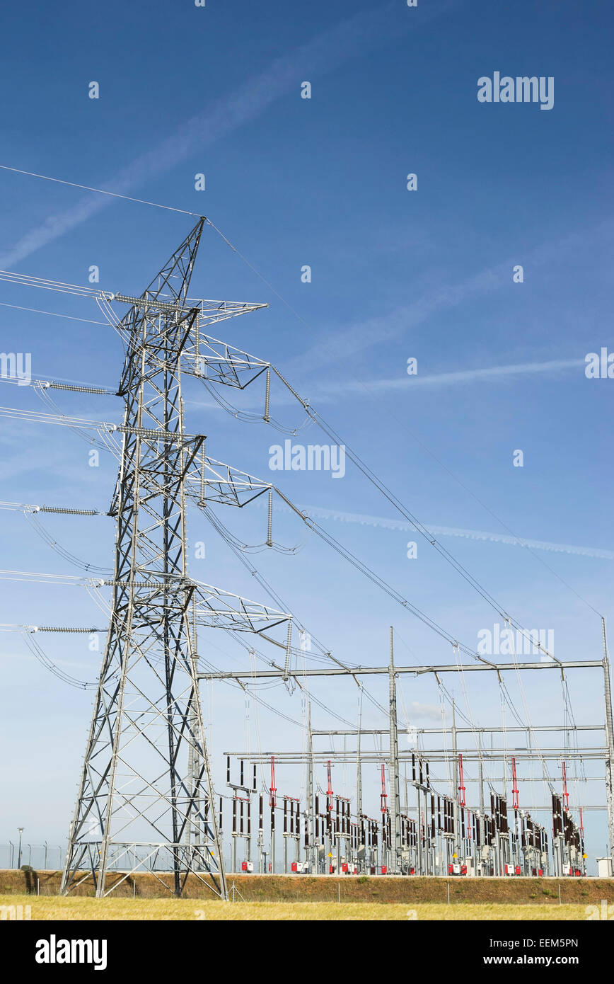 Power line pole for electrical energy distribution near a transformation station - Stock Image