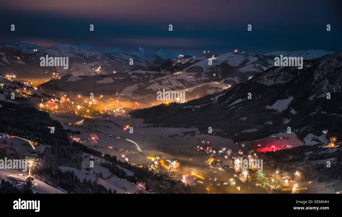 Fireworks over the Alps, Hochbrixen and Kirchberg, Brixen im Thale, Tyrol, Austria - Stock Image