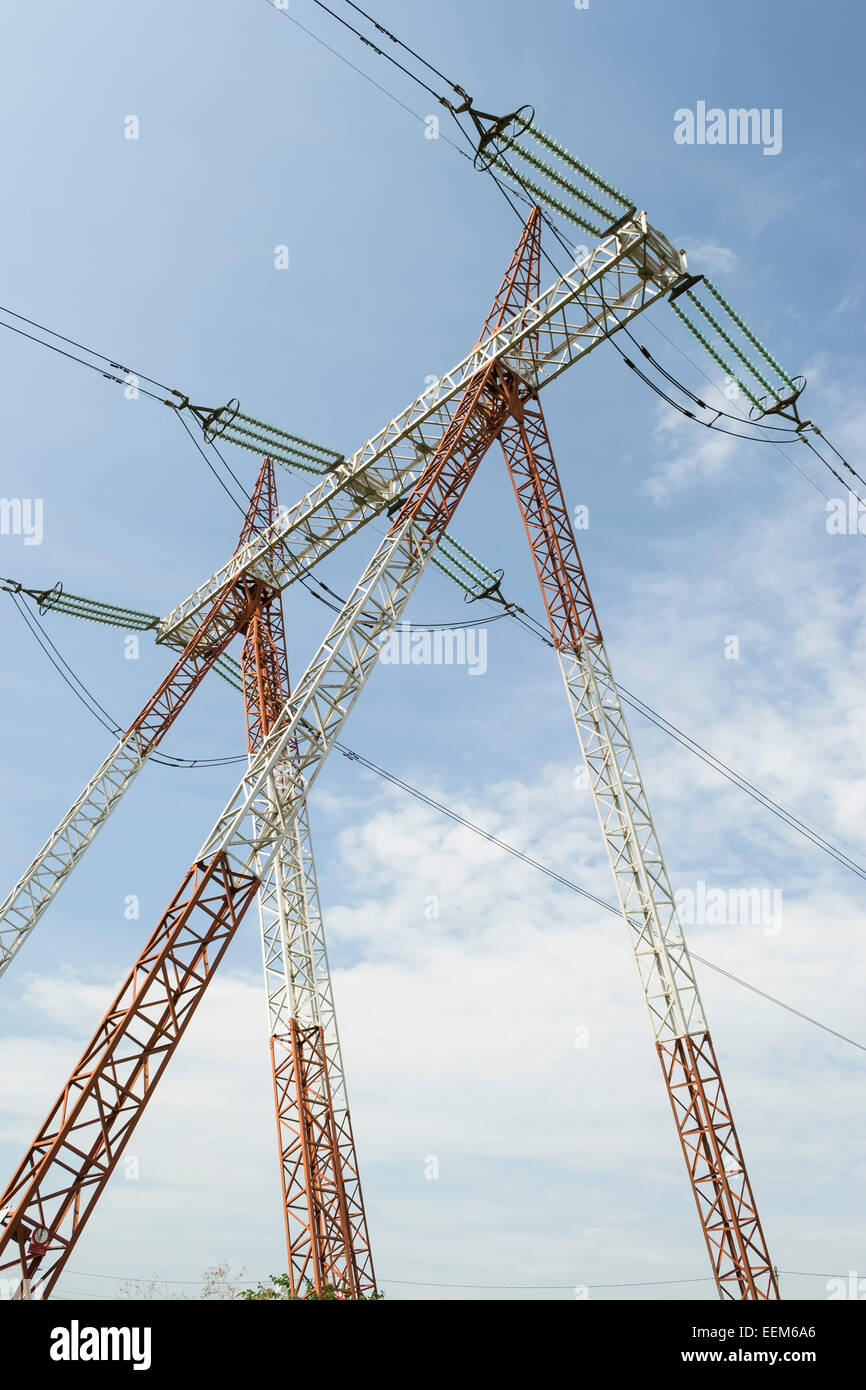 High voltage power line pole as part of a wide area electrical energy distribution grid - Stock Image