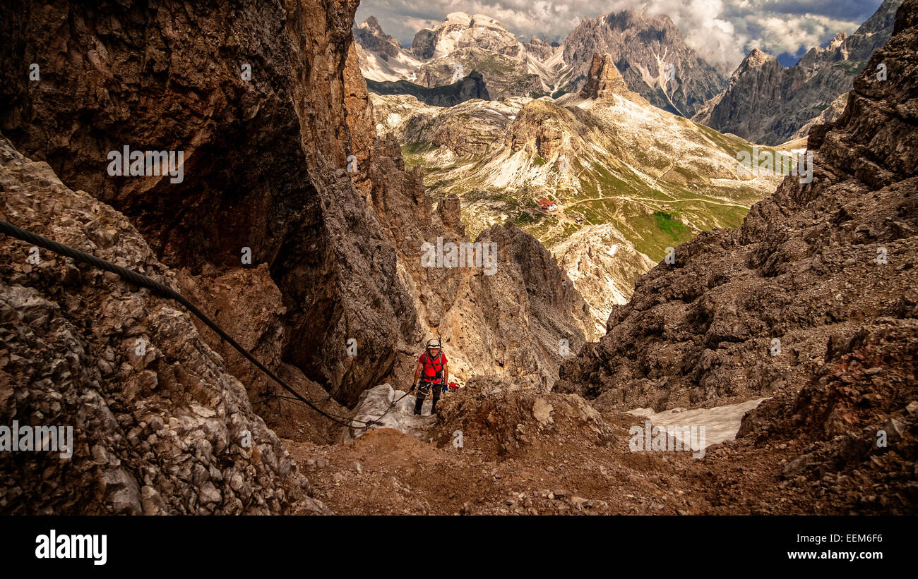 Italy, Hiker going up mountain pass - Stock Image