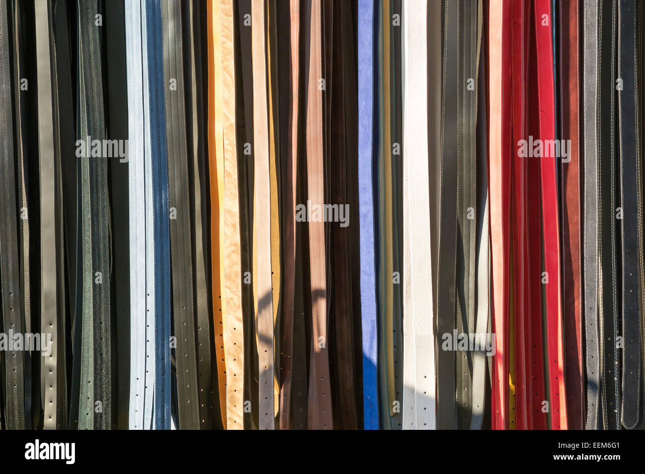 Fashionable leather belts for men and women, background - Stock Image