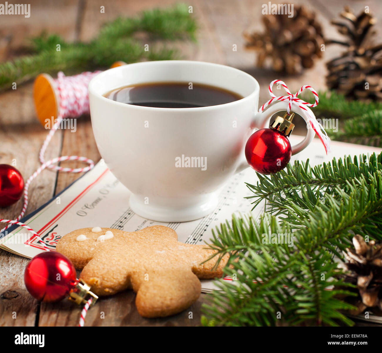 Cup of coffee and gingerbread cookie with christmas decorations - Stock Image