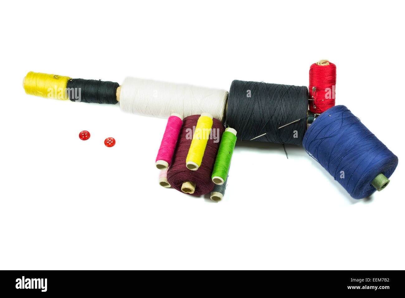 Machine gun   improvised from colored sewing thread reels giving the resemblance of a firearm - Stock Image