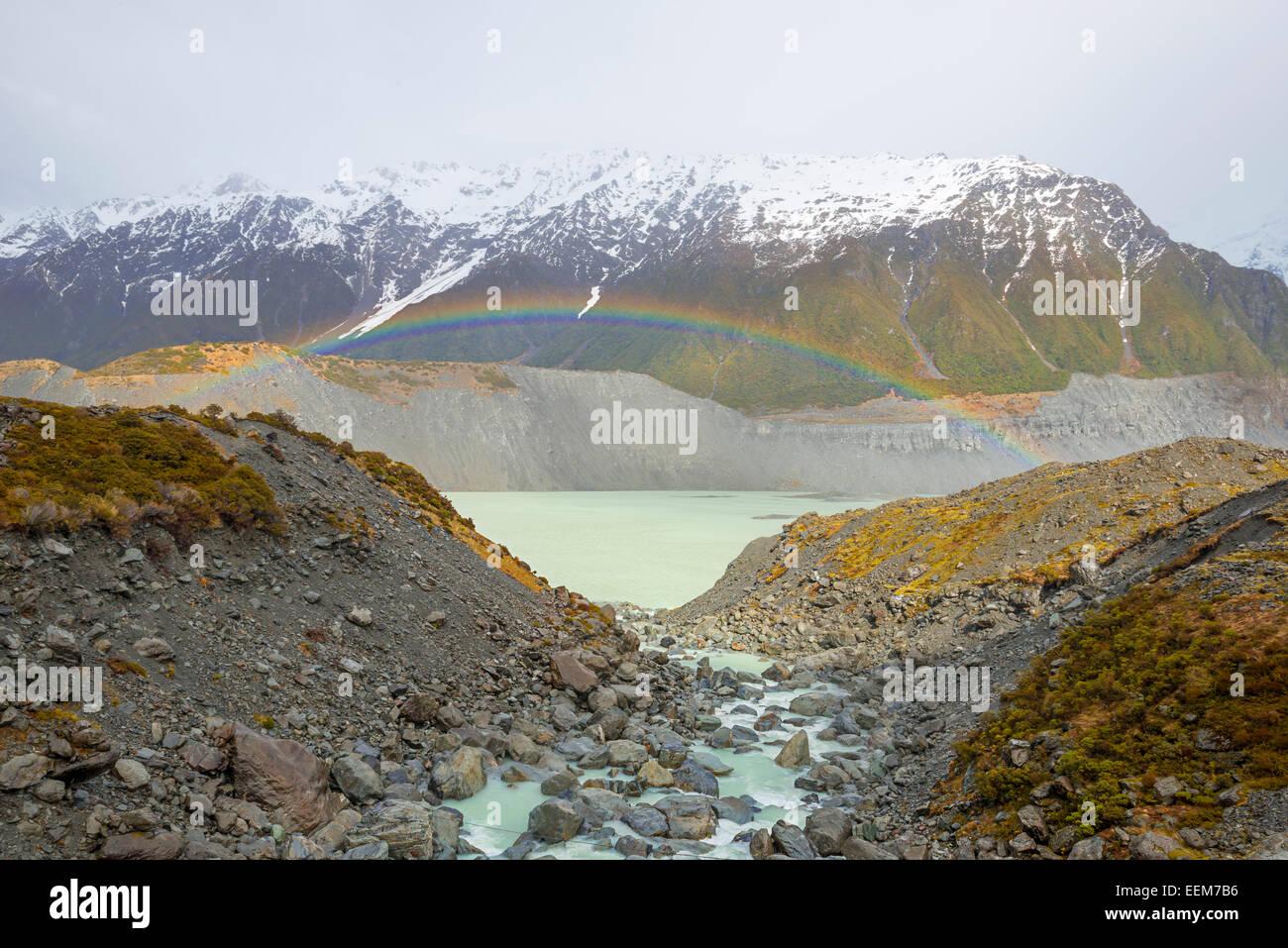 New Zealand, Canterbury region, Rainbow over Mueller Glacier Lake - Stock Image