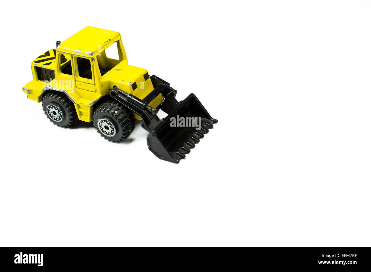 Scale Model Toy Of A Front Loader Construction Machinery On White Background