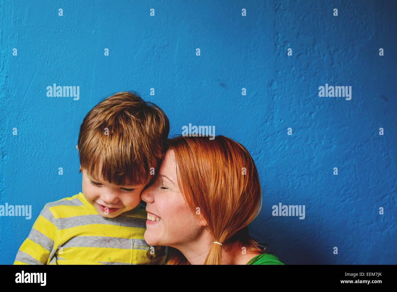 Mother nuzzling son's (2-3) face - Stock Image