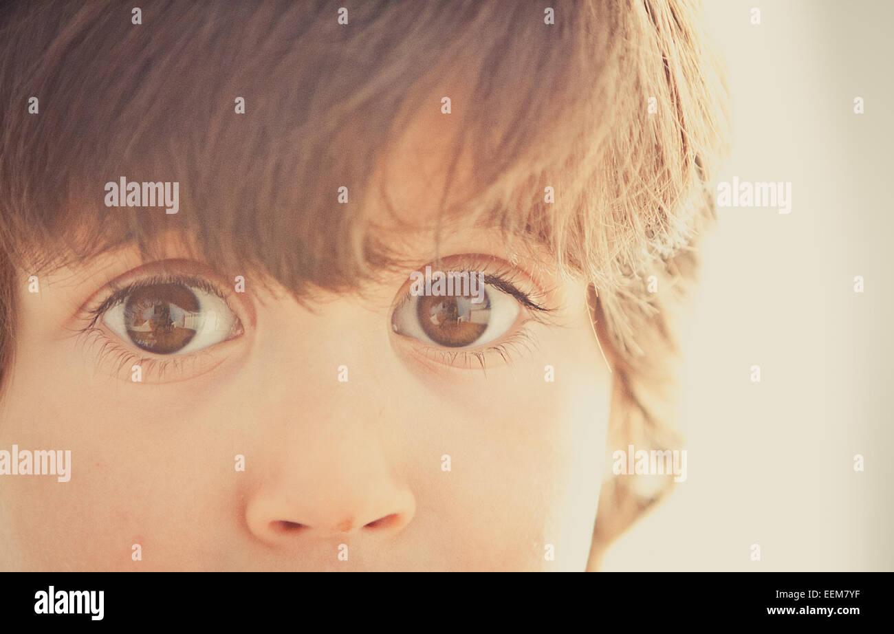 Boy (2-3) with big eyes staring at camera - Stock Image
