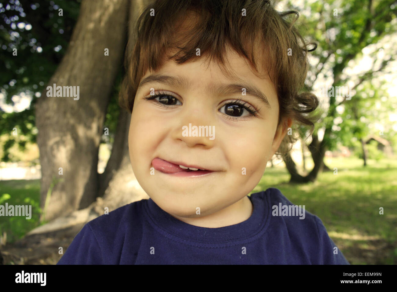 Little boy (18-23 months) making face - Stock Image