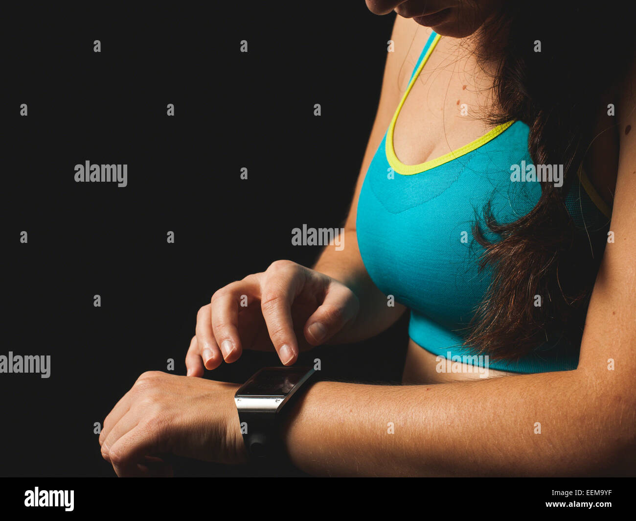 Woman looking at smart watch - Stock Image