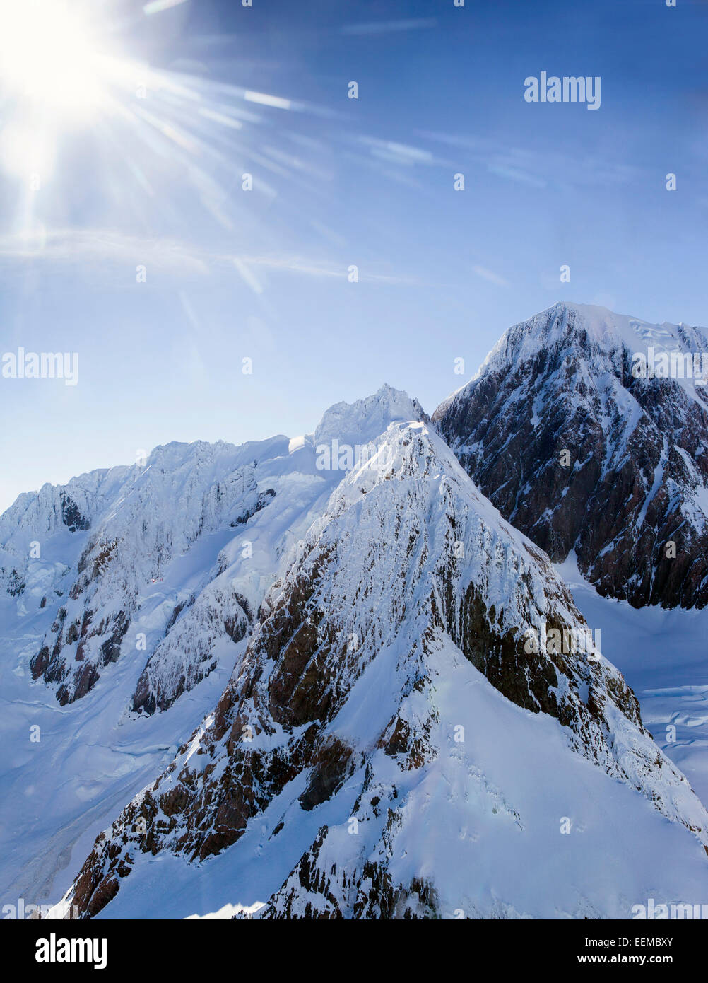 Snow covered mountain tops - Stock Image