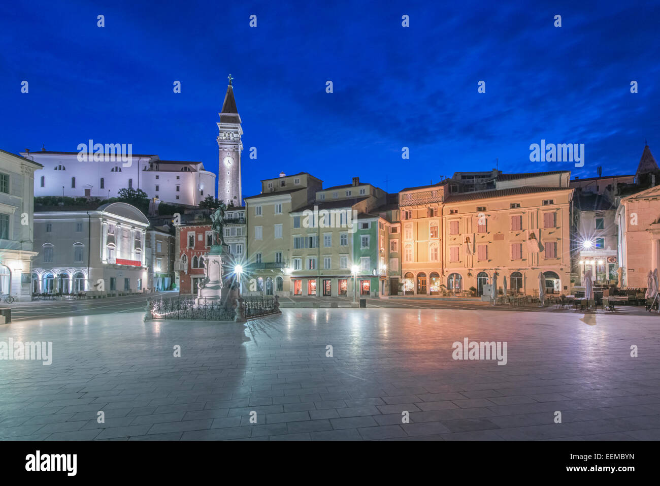 Town square, tower and buildings illuminated at night, Piran, Coastal-Karst, Slovenia - Stock Image
