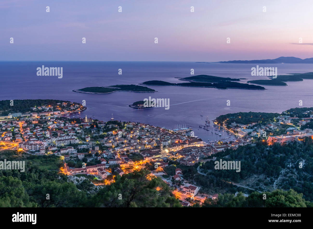 Aerial view of coastal town illuminated at night - Stock Image