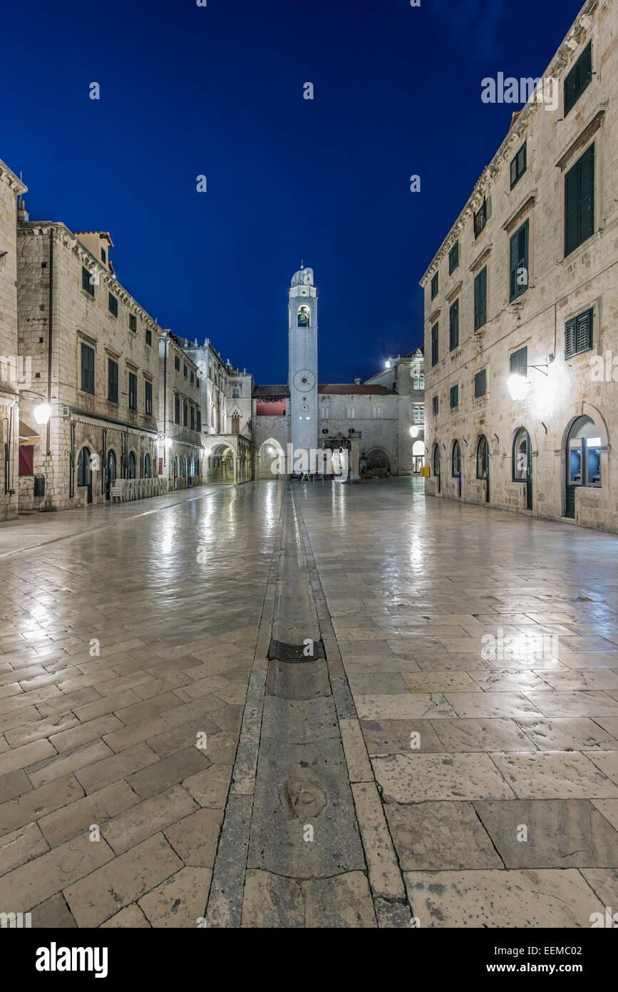 Town square, buildings and tower illuminated at night, Dubrovnik, Dubrovnik-Neretva, Croatia - Stock Image
