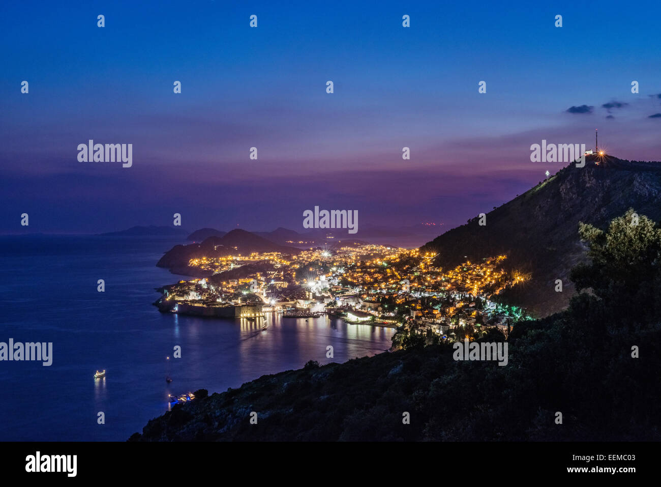 Aerial view of coastal city illuminated at night, Dubrovnik, Dubrovnik-Neretva, Croatia - Stock Image