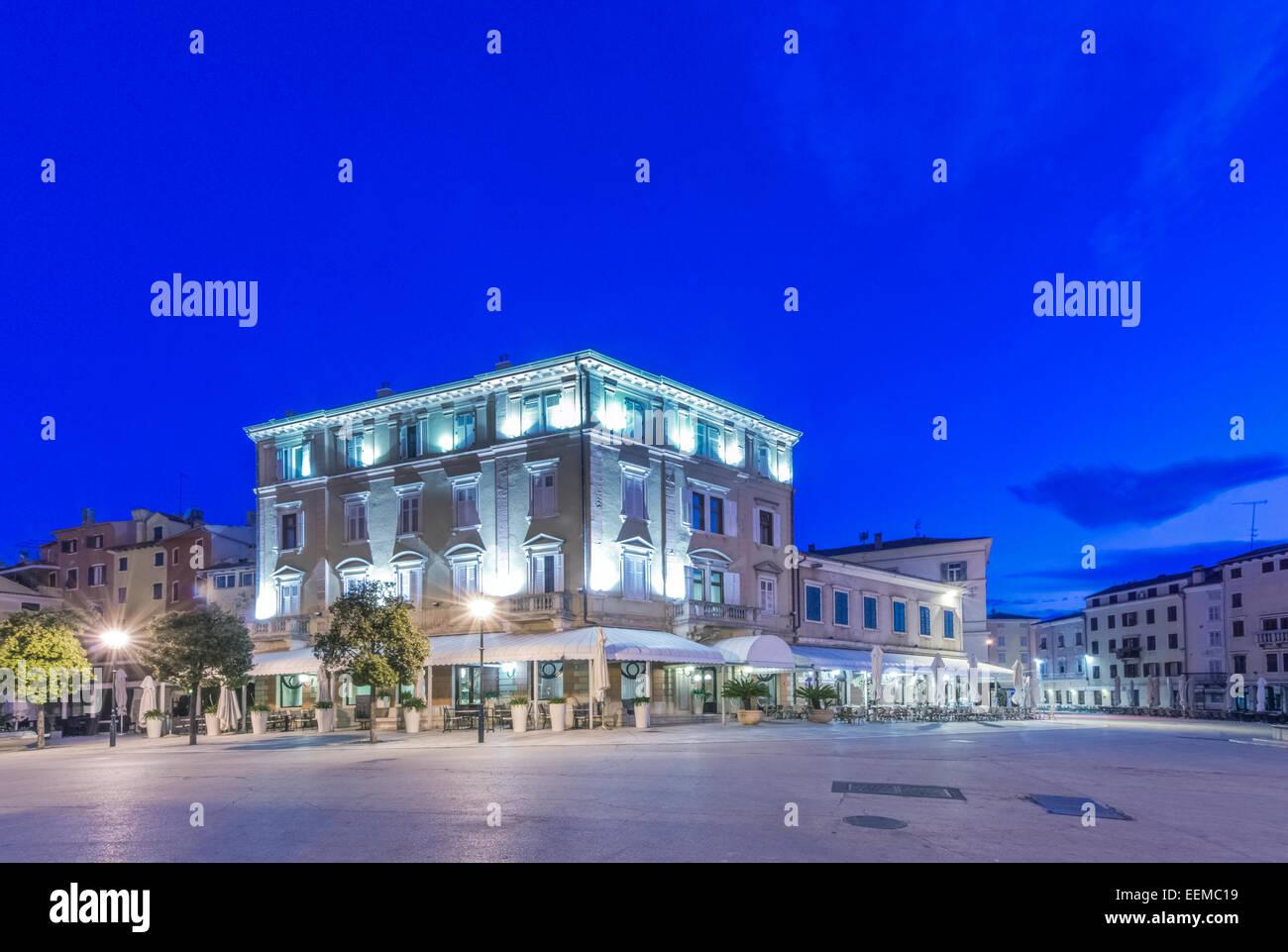 Illuminated town square and buildings at night, Rovinj, Istria, Croatia - Stock Image