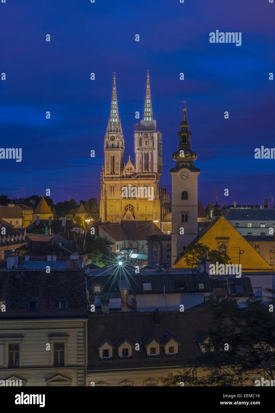 Cathedral spires over rooftops in cityscape, Zagreb, Zagreb, Croatia Stock Photo