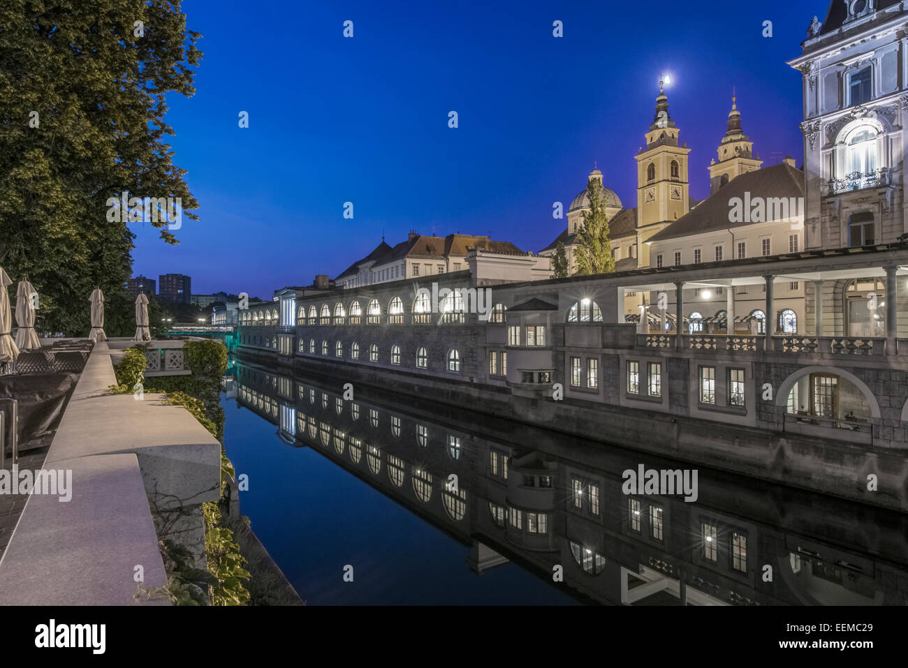 Church and walkways near urban canal, Ljubljana, Central Slovenia, Slovenia - Stock Image