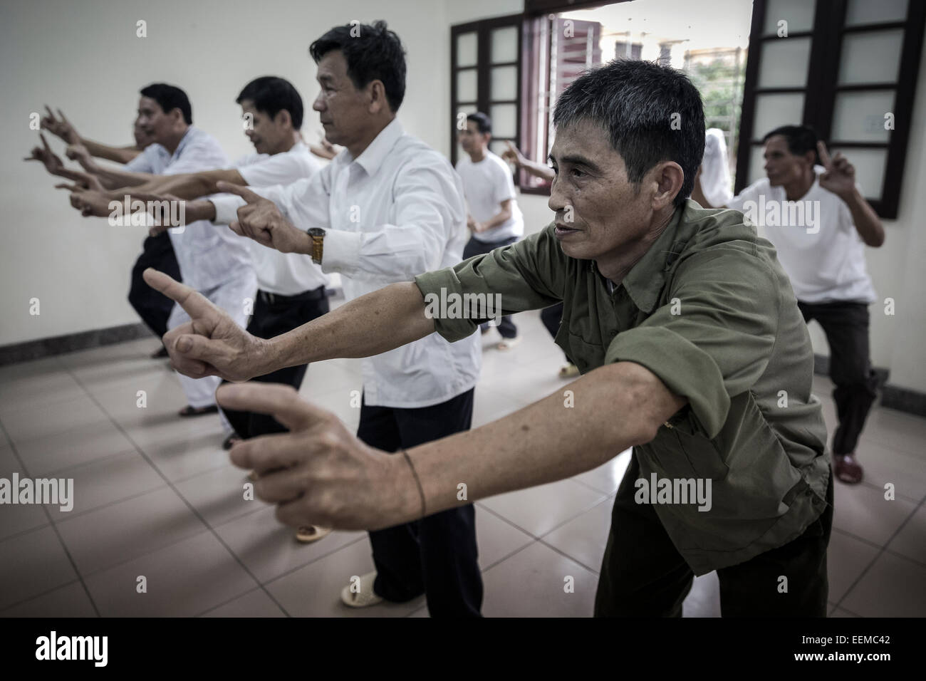 Several war veterans affected by Agent Orange attend an exercise class to improve your health with ailments. - Stock Image